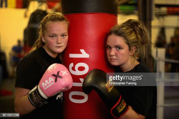 Female boxers Ellie Hyde Olivia Hussey both aged 16 pose during training at the Hook Jab Boxing Gym on September 12 2016 in Warrington England The...