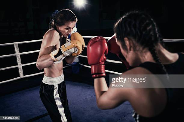 Female boxers fighting in a boxing ring