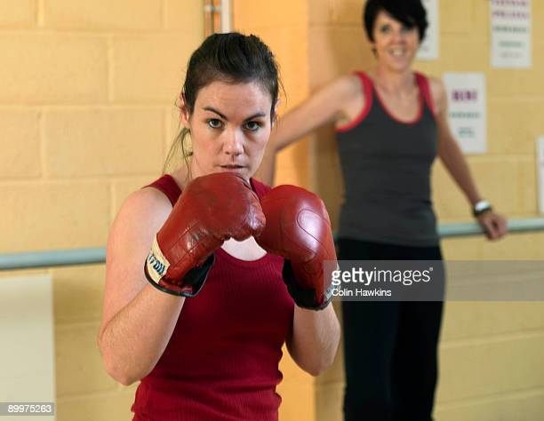 female boxing exercise at gym - women's boxing stock pictures, royalty-free photos & images
