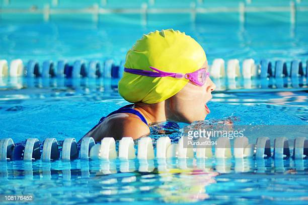Female Breaststroke Competitive Sports Swimmer Racing in Pool