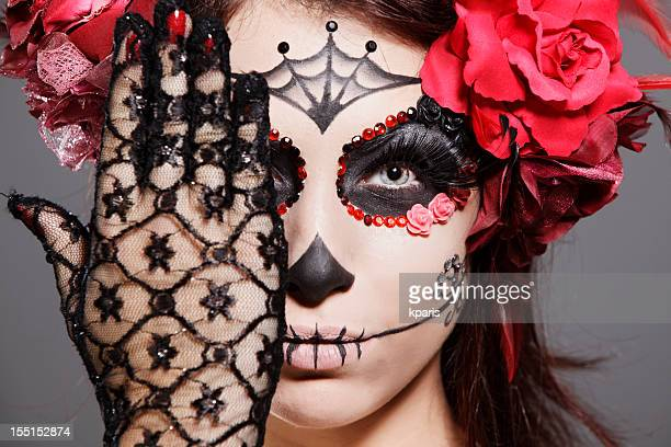 Female brunette in scary makeup acknowledges Day of the Dead