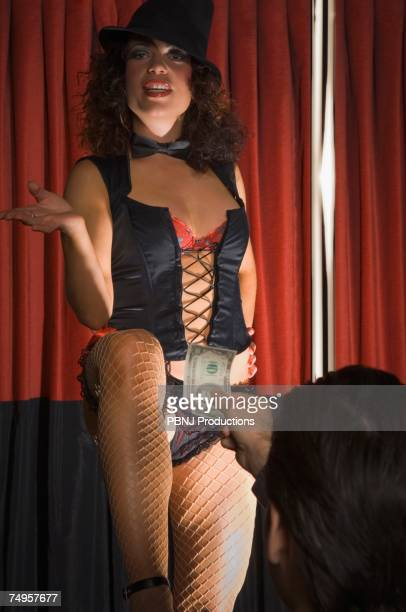 Female burlesque dancer accepting money