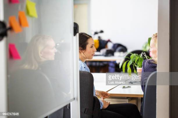 Female business colleagues discussing at office