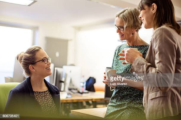 Female business colleagues enjoying coffee
