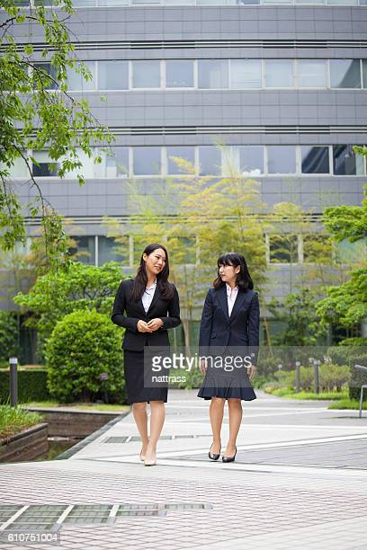 Female Business colleagues walking in business park