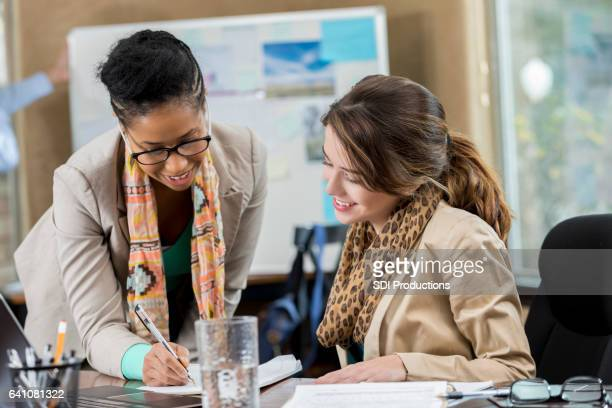 Female business colleagues work together in the office