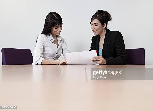 female business colleagues working together in office - hugh sitton stock pictures, royalty-free photos & images