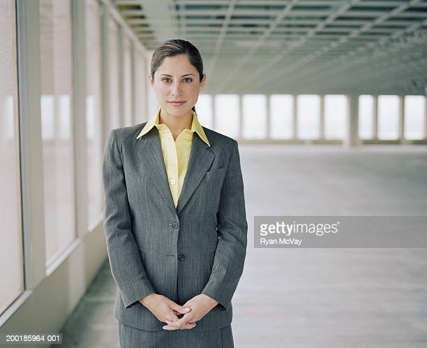 Female business executive in empty office space, portrait