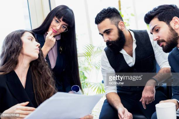 female business executive leading a team through a major business project - bahrain stock pictures, royalty-free photos & images