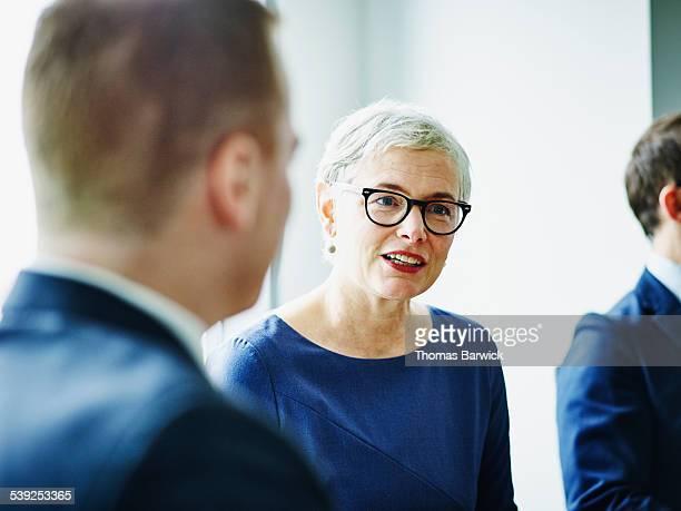 Female business executive leading team meeting