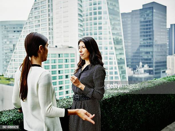 Female business executives in discussion on deck