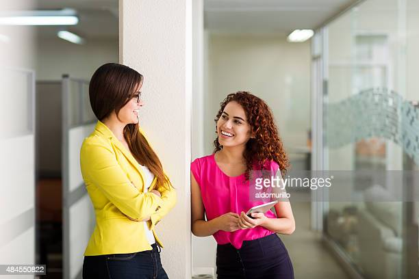 Female business executives talking