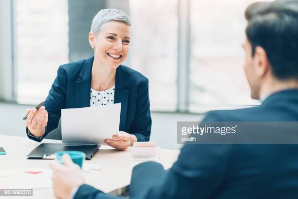 female business leader - mid adult women stock pictures, royalty-free photos & images