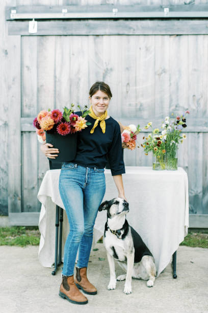 Female business owner and flower farmer with her dog