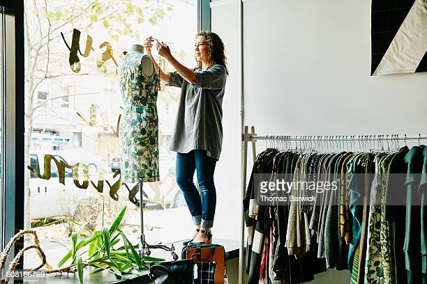 Female business owner dressing dress form