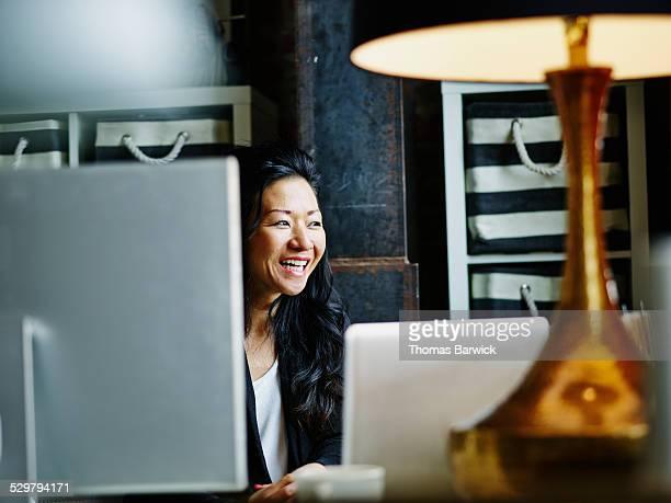 Female business owner sitting at workstation