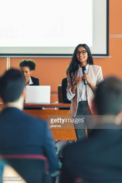 female business presenter - press conference stock pictures, royalty-free photos & images