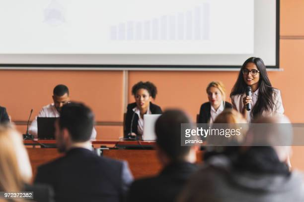 female business presenter - summit meeting stock pictures, royalty-free photos & images