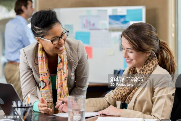 Female business professionals work together in the office