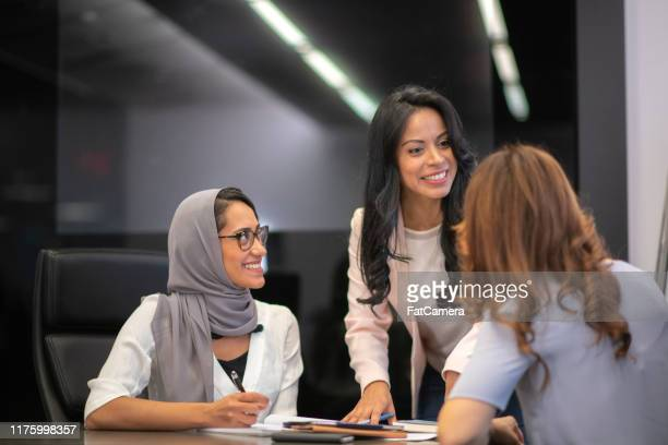 female business team in strategy meeting - international politics stock pictures, royalty-free photos & images