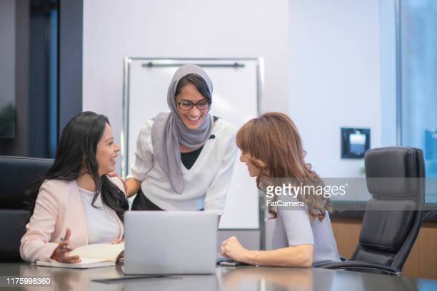 female business team in strategy meeting - global politics stock pictures, royalty-free photos & images