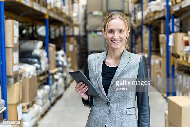 Female businesswoman checking the stocks and using tablet