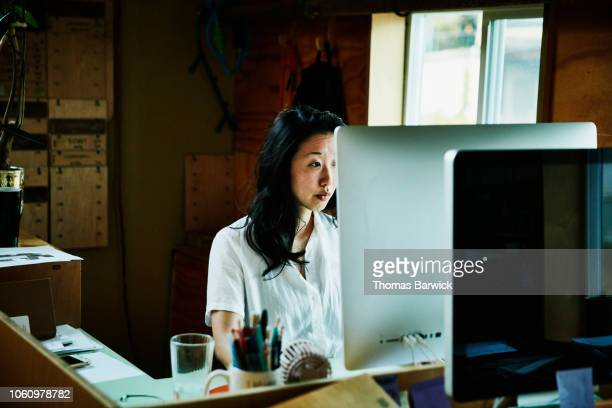 Female businesswoman working on computer in small office