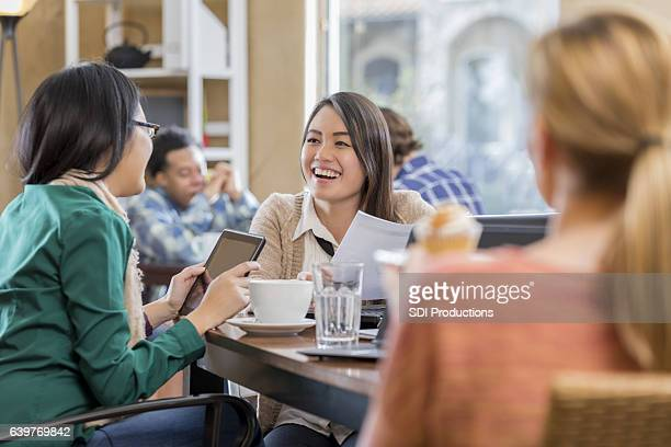 Female businesswomen meet for coffee before work