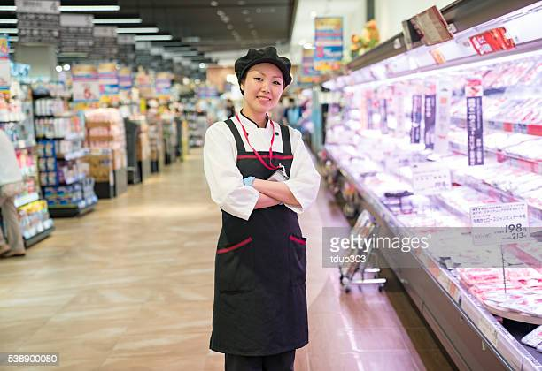 Female butcher in a supermarket