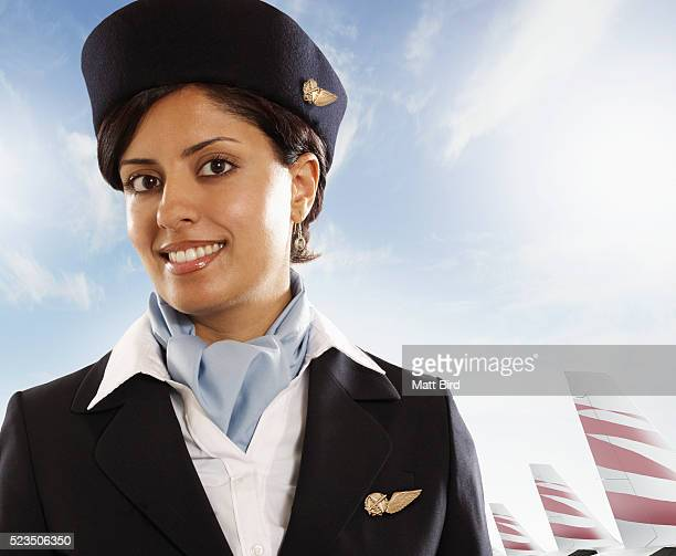 Female cabin crew member at airport