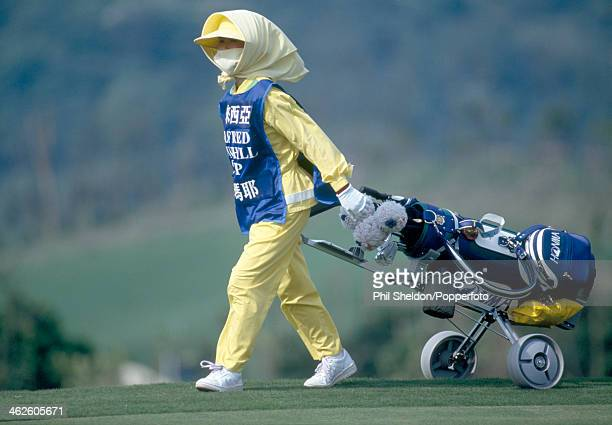 A female caddie pulling a golf cart during the Alfred Dunhill Cup Qualifying Event held at the Sunrise Golf Club Taiwan circa 1993