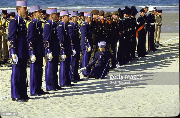 Female cadet from French Ecole Militaire faints during ceremonies on 40th anniversary of DDay on Utah beach Normandy