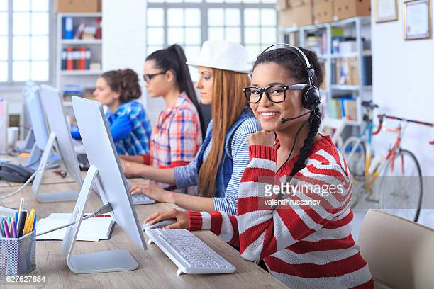 Female call centre team working at workplace