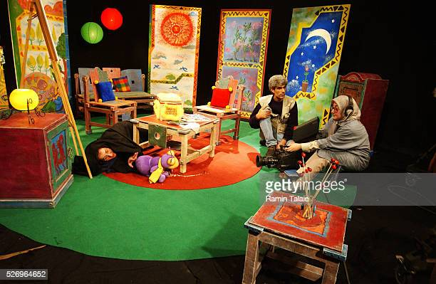 Female camera operator and actor on the set of a television program for Iranian children Unlike other Islamic countries in the region women in Iran...