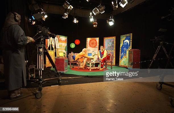 A female camera operator filming a television program for Iranian children Unlike other Islamic countries in the region women in Iran play a major...
