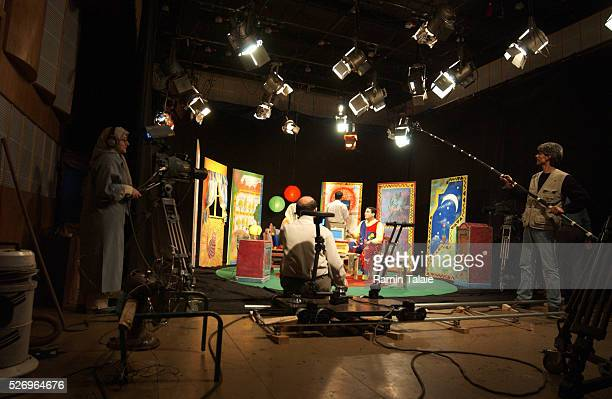 A female camera operator on the set of a television program for Iranian children Unlike other Islamic countries in the region women in Iran play a...