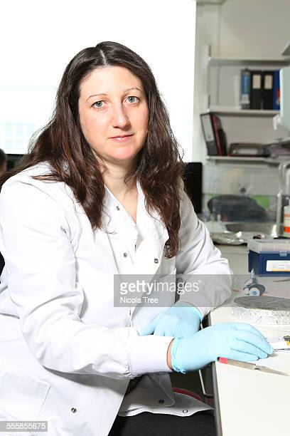 Female cancer researcher in her laboratory