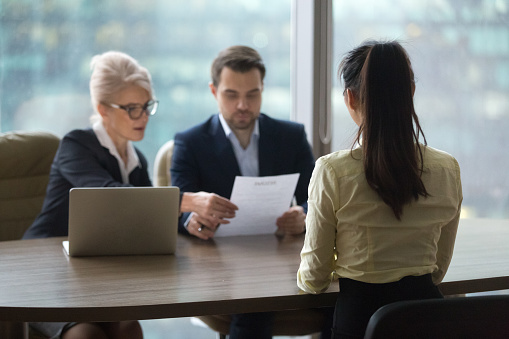 Female candidate interview with HR managers in office 1070079846