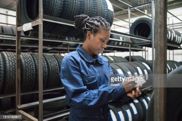 female car mechanic at work - izusek stock pictures, royalty-free photos & images