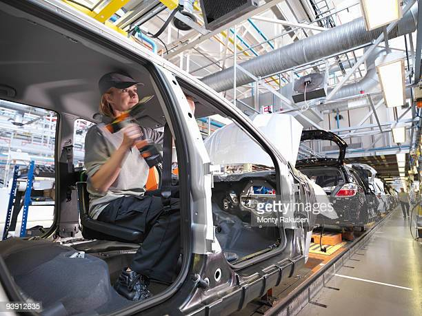 Female Car Worker On Production Line