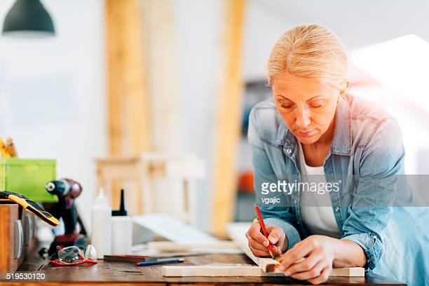 Female Carpenter At Work In Her Office.