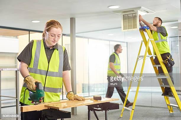 female carpenter office fitout