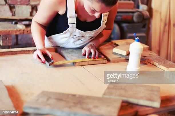 female carpenter - menschliches körperteil stock pictures, royalty-free photos & images
