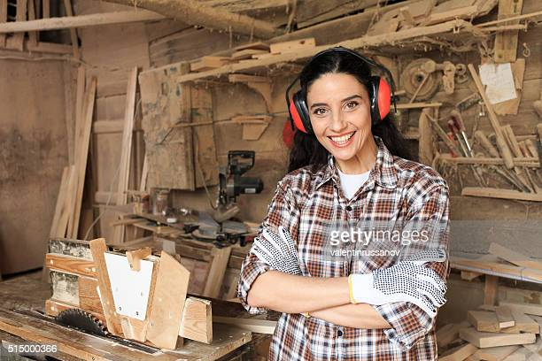 Female carpenter with noise-cancelling headphones