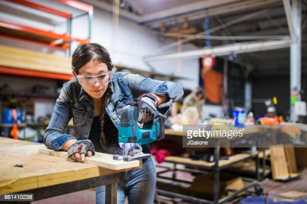 Female carpenter working in a workshop