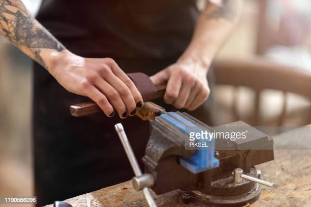 female carpenter working vice grip