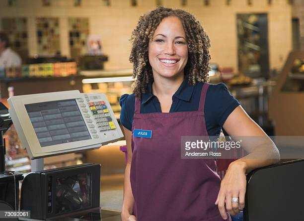 female cashier smiling, portrait - assistant stock pictures, royalty-free photos & images