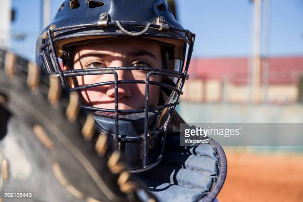 female catcher ready to catch the ball during a baseball game - face guard sport stock pictures, royalty-free photos & images