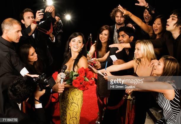female celebrity smiling on the red carpet - ルポルタージュ ストックフォトと画像