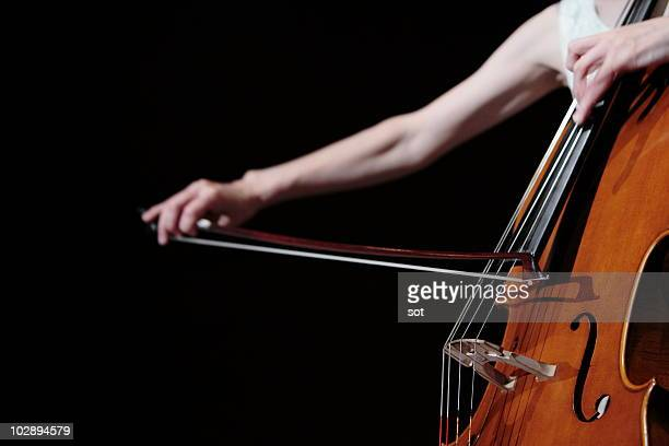 A female cellist playing cello on stage,close up